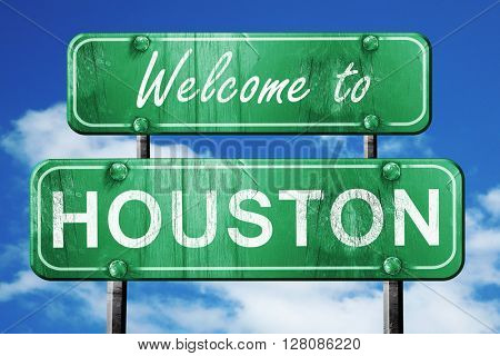 houston vintage green road sign with blue sky background