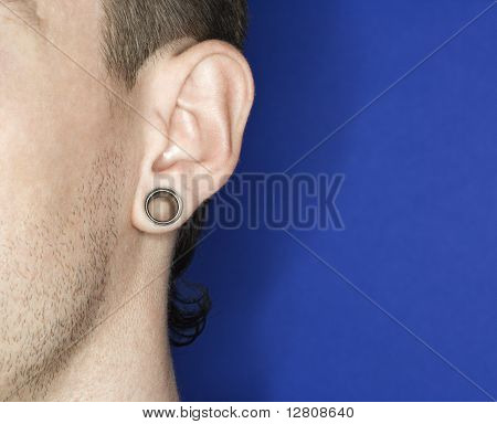 Young adult Caucasian male pierced ear.