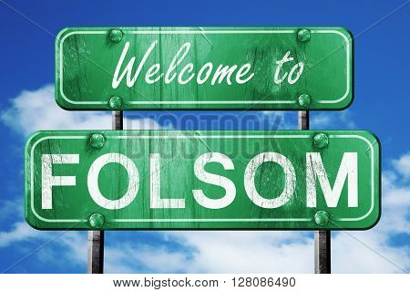 folsom vintage green road sign with blue sky background