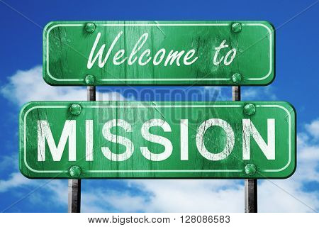 mission vintage green road sign with blue sky background