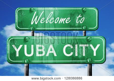 yuba city vintage green road sign with blue sky background