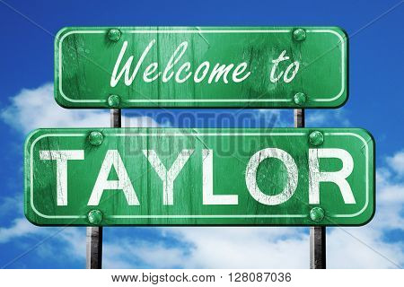 taylor vintage green road sign with blue sky background