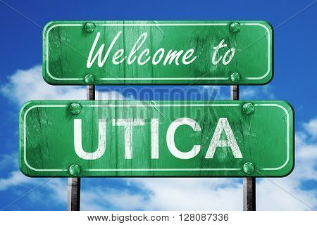 utica vintage green road sign with blue sky background