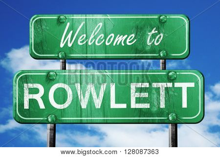 rowlett vintage green road sign with blue sky background