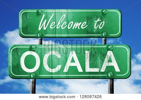 ocala vintage green road sign with blue sky background