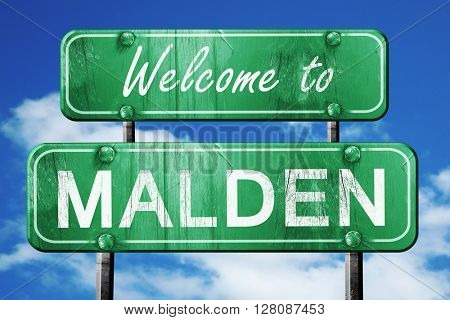 malden vintage green road sign with blue sky background