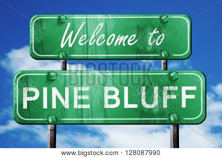 pine bluff vintage green road sign with blue sky background