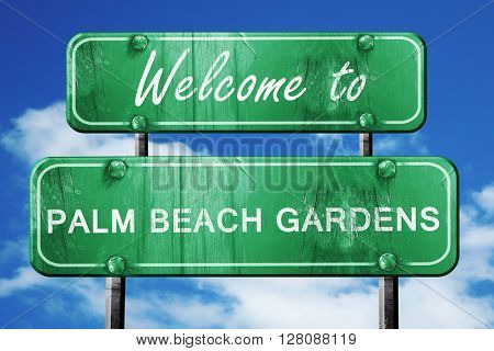 palm beach gardens vintage green road sign with blue sky backgro