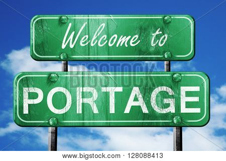 portage vintage green road sign with blue sky background