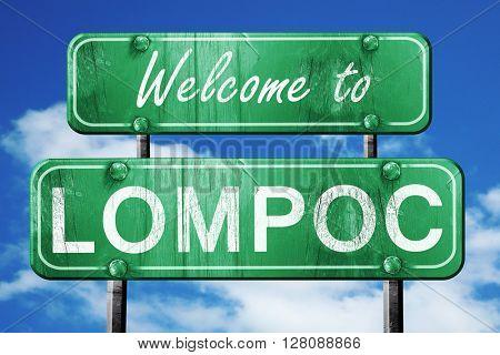 lompoc vintage green road sign with blue sky background