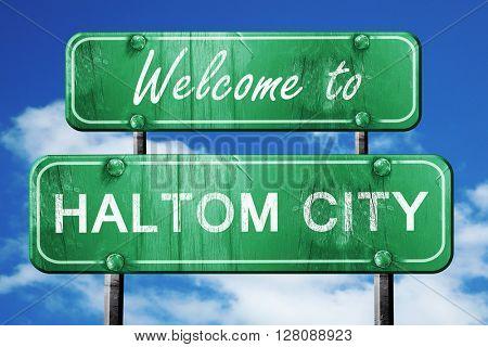 haltom city vintage green road sign with blue sky background