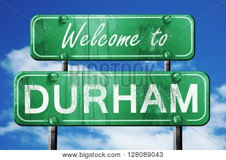 durham vintage green road sign with blue sky background