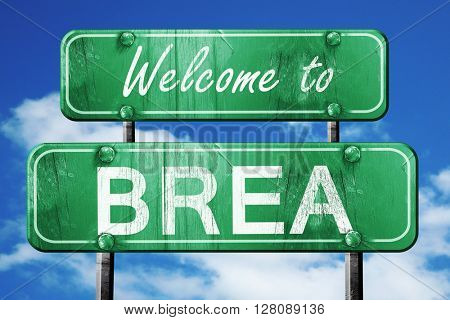 brea vintage green road sign with blue sky background