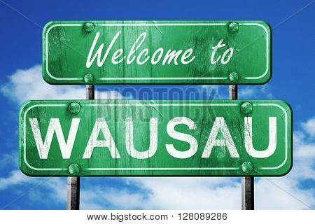 wausau vintage green road sign with blue sky background