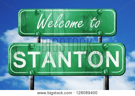 stanton vintage green road sign with blue sky background