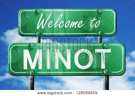 minot vintage green road sign with blue sky background