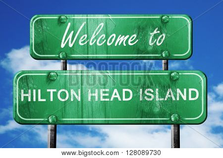 hilton head island vintage green road sign with blue sky backgro