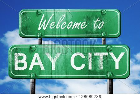 bay city vintage green road sign with blue sky background