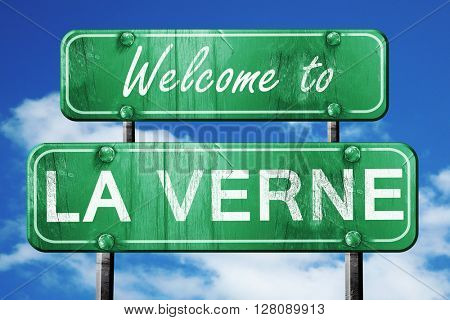 la verne vintage green road sign with blue sky background