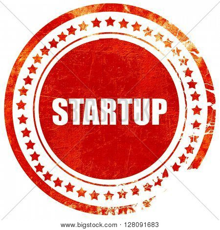 startup, grunge red rubber stamp with rough lines and edges
