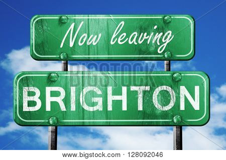 Leaving brighton, green vintage road sign with rough lettering