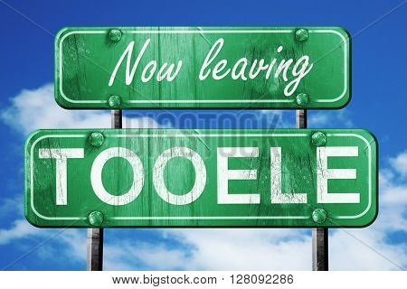 Leaving tooele, green vintage road sign with rough lettering