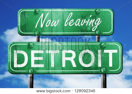 Leaving detroit, green vintage road sign with rough lettering