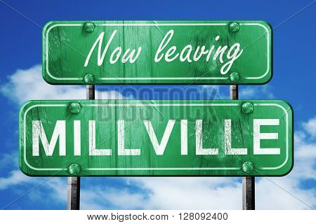 Leaving millville, green vintage road sign with rough lettering