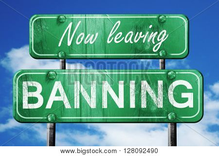 Leaving banning, green vintage road sign with rough lettering