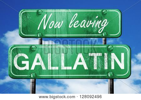 Leaving gallatin, green vintage road sign with rough lettering