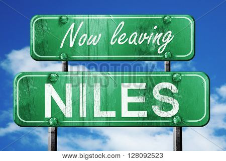 Leaving niles, green vintage road sign with rough lettering