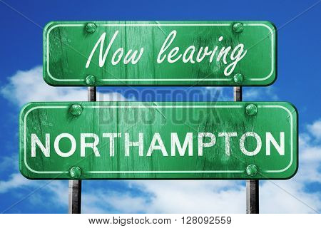 Leaving northhampton, green vintage road sign with rough letteri
