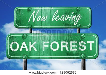 Leaving oak forest, green vintage road sign with rough lettering