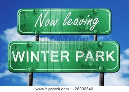 Leaving winter park, green vintage road sign with rough letterin