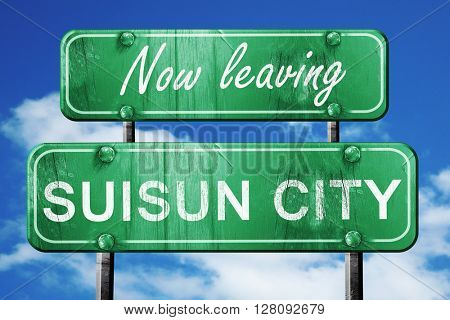 Leaving suisun city, green vintage road sign with rough letterin