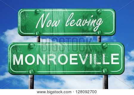 Leaving monroeville, green vintage road sign with rough letterin