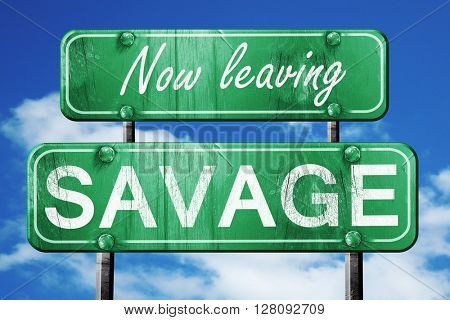 Leaving savage, green vintage road sign with rough lettering