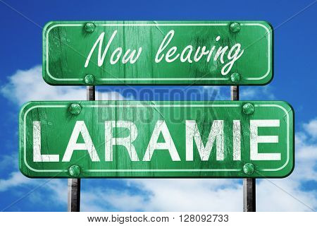 Leaving laramie, green vintage road sign with rough lettering