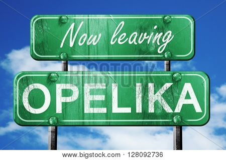 Leaving opelika, green vintage road sign with rough lettering