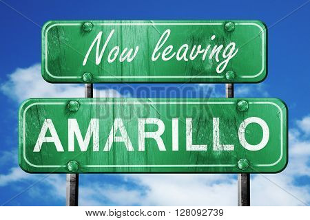 Leaving amarillo, green vintage road sign with rough lettering