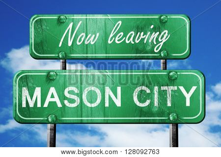 Leaving mason city, green vintage road sign with rough lettering