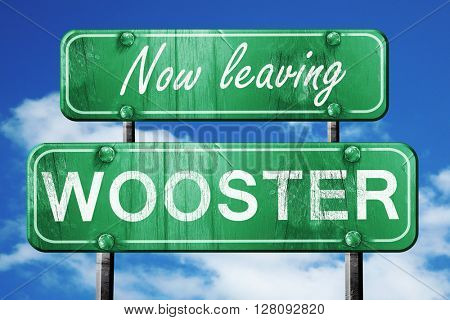 Leaving wooster, green vintage road sign with rough lettering
