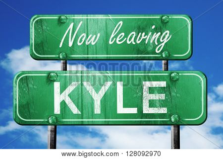 Leaving kyle, green vintage road sign with rough lettering