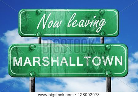 Leaving marshalltown, green vintage road sign with rough letteri