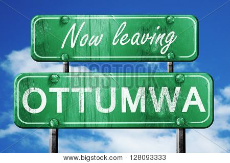 Leaving ottumwa, green vintage road sign with rough lettering