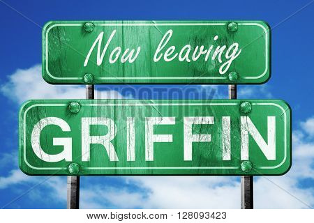 Leaving griffin, green vintage road sign with rough lettering