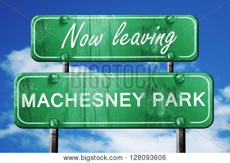 Leaving machesney park, green vintage road sign with rough lette