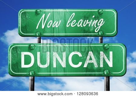 Leaving duncan, green vintage road sign with rough lettering
