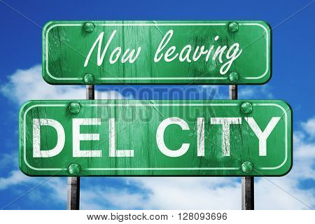 Leaving del city, green vintage road sign with rough lettering