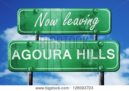 Leaving agoura hills, green vintage road sign with rough letteri